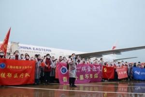 欢迎回家上海援助湖北医疗队700多人先后抵达虹桥机场